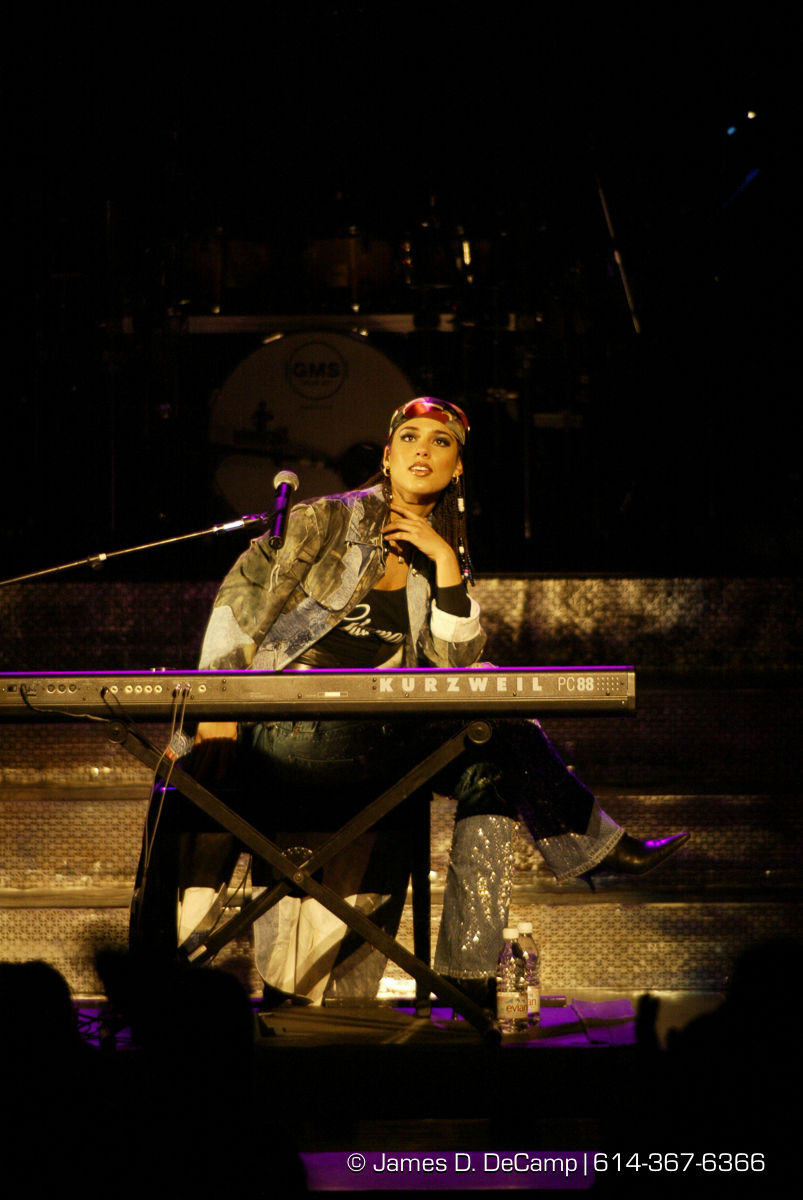 Alicia Keys gets the crowd on their feet at the Palace Theatre in Columbus Ohio Monday February 4, 2002. (© James D. DeCamp | http://www.JamesDeCamp.com | 614-367-6366)
