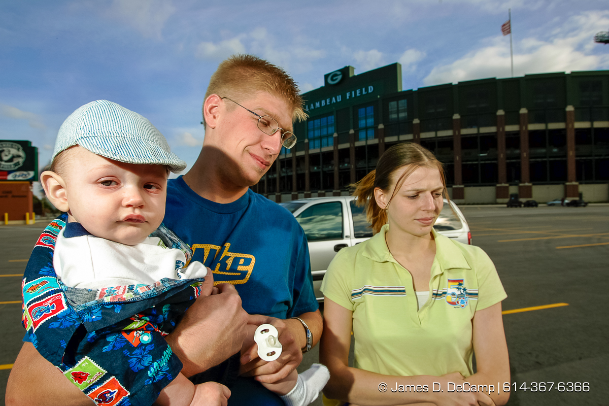 left to right - Jeffery Virtues, 6 Months, Brian Virtues, and Anne Ullmer came out to Lambeau Field to sign up for a radio station ticket giveaway in Green Bay Friday afternoon September 24, 2004. Day 1 of the 2004 'Real People Tour' of middle America. (© James D. DeCamp | http://www.JamesDeCamp.com | 614-367-6366) [Photographed with Canon 1D MkII cameras in RAW mode with L series lenses]