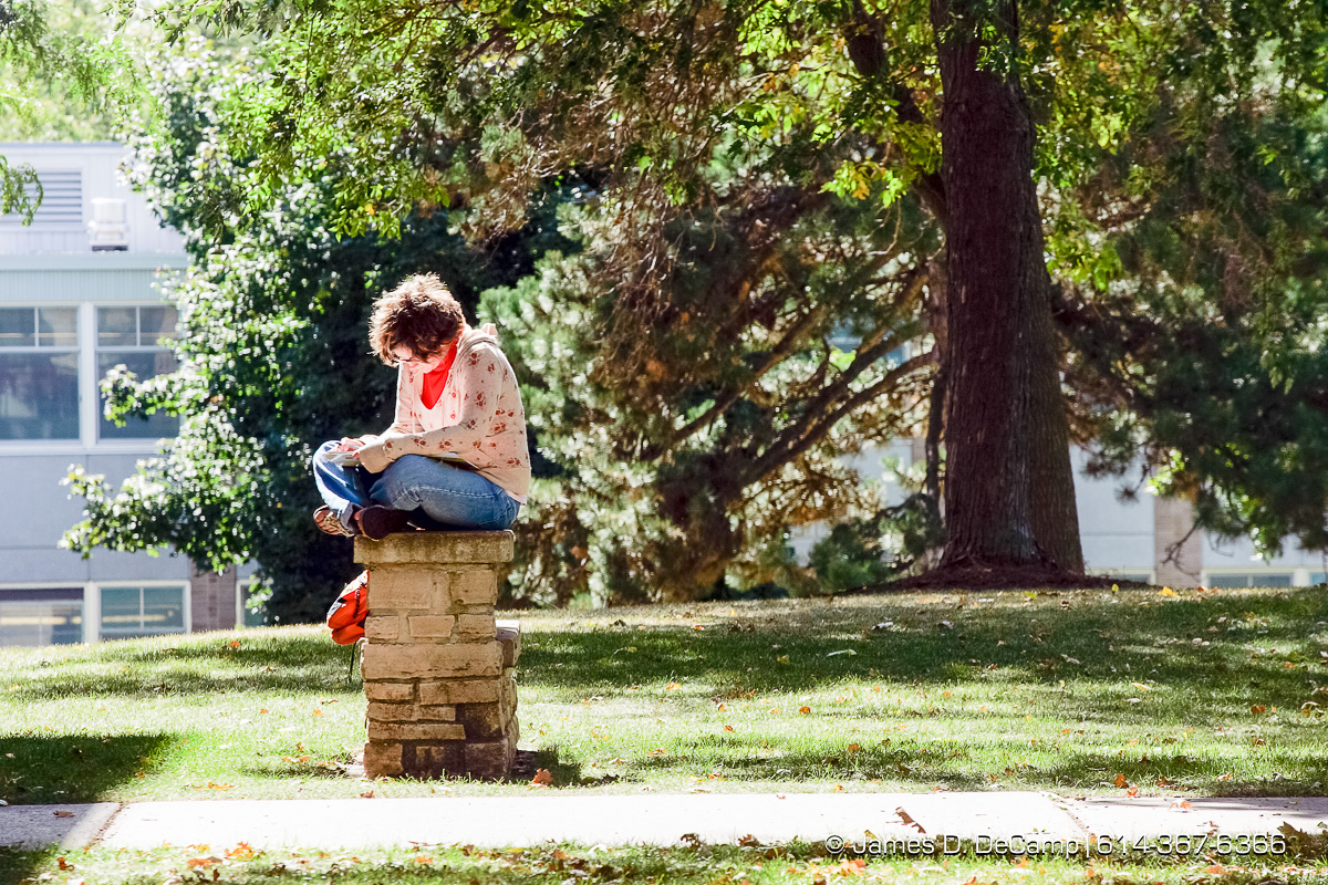 Megan Calder, Freshman at Ripon University, studies for her German class on the campus green Friday afternoon September 24, 2005. Day 1 of the 2004 'Real People Tour' of middle America. (© James D. DeCamp | http://www.JamesDeCamp.com | 614-367-6366) [Photographed with Canon 1D MkII cameras in RAW mode with L series lenses]