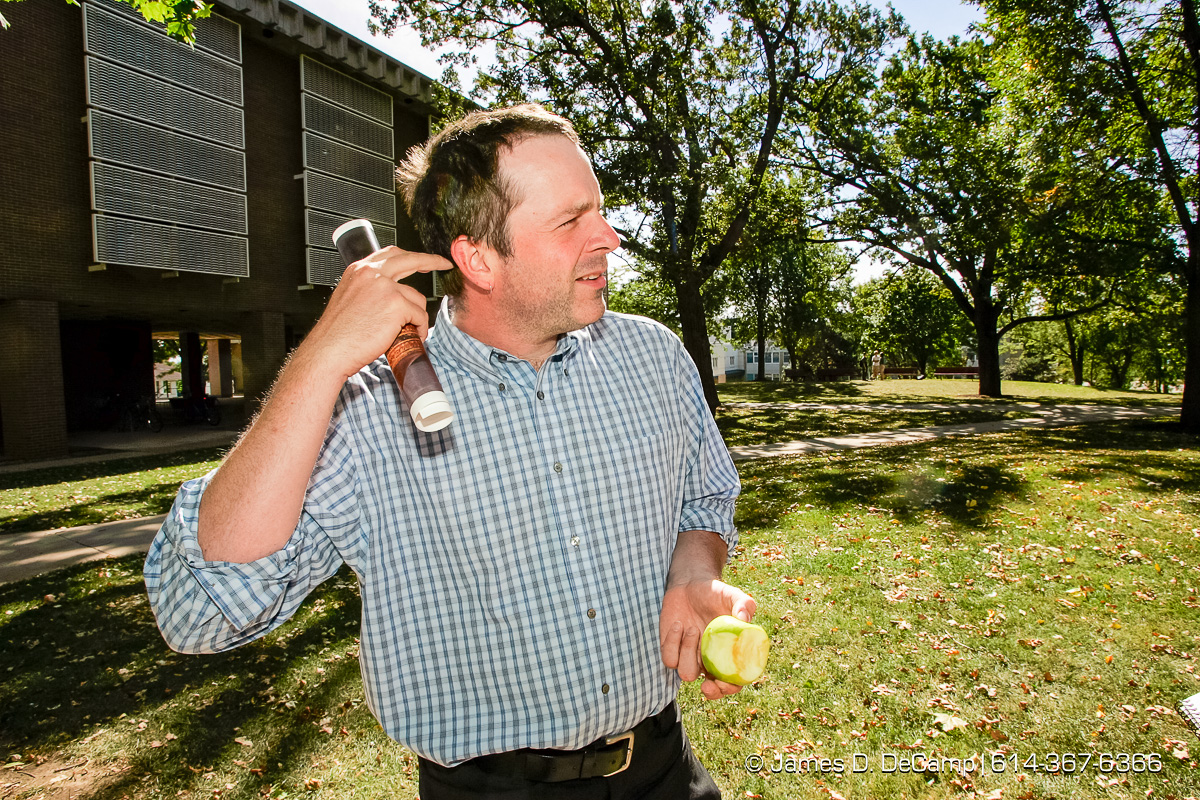 Bill Whitehead, Professor at Ripon University, talks with us on the campus green Friday afternoon September 24, 2005. Day 1 of the 2004 'Real People Tour' of middle America. (© James D. DeCamp | http://www.JamesDeCamp.com | 614-367-6366) [Photographed with Canon 1D MkII cameras in RAW mode with L series lenses]