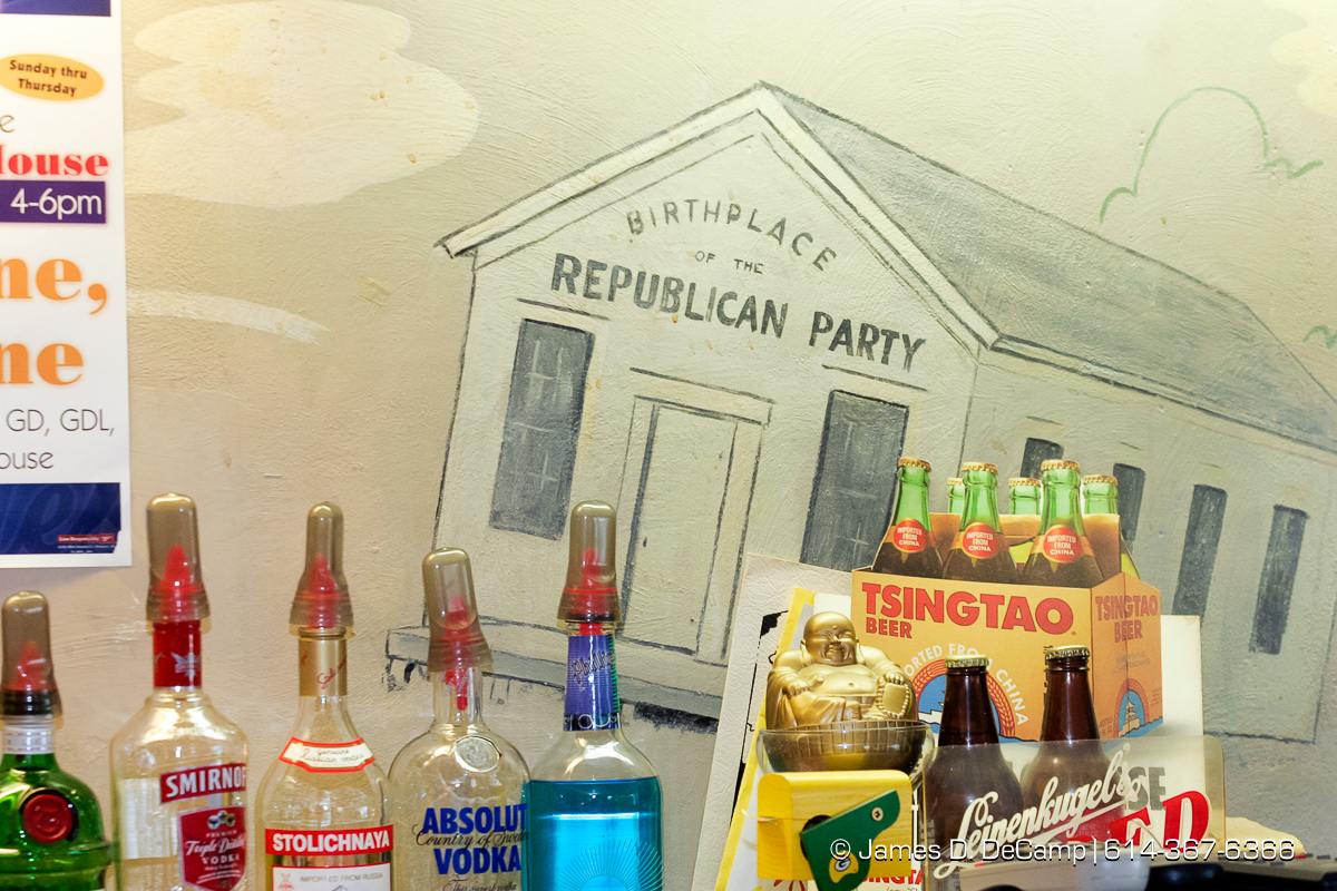 A painting on the wall behind the bar of the Republican House Chinese restaurant depicts the little white school house which is the birthplace of the Republican Party in Ripon WI photographed Friday afternoon September 24, 2005. Day 1 of the 2004 'Real People Tour' of middle America. (© James D. DeCamp | http://www.JamesDeCamp.com | 614-367-6366) [Photographed with Canon 1D MkII cameras in RAW mode with L series lenses]