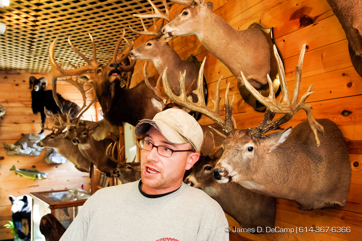 Glen Brown, waits for his deer head at Darwin Kumlin Taxidermist service in De Soto Wisconsin on September 25, 2004 on day 2 of the 2004 'Real People Tour' of middle America. (© James D. DeCamp | http://www.JamesDeCamp.com | 614-367-6366) [Photographed with Canon 1D MkII cameras in RAW mode with L series lenses]