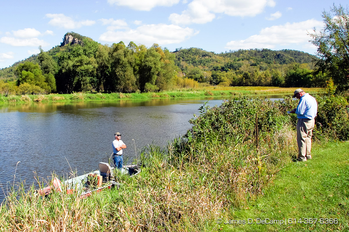 Joe Hallet, left, interviews Lee Williams as he fishes in the Goose Island County Park near Genoa Wisconsin along the Missouri River during day 2 of the 2004 'Real People Tour' of middle America. (© James D. DeCamp | http://www.JamesDeCamp.com | 614-367-6366) [Photographed with Canon 1D MkII cameras in RAW mode with L series lenses]