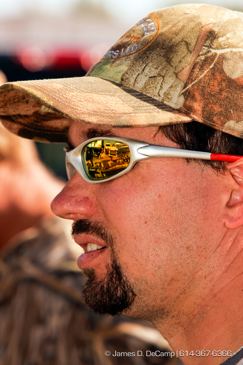 Chip Schilling takes a break after a morning of duck hunting just south of La Crosse Wisconsin along the Missouri River during day 2 of the 2004 'Real People Tour' of middle America. (© James D. DeCamp | http://www.JamesDeCamp.com | 614-367-6366) [Photographed with Canon 1D MkII cameras in RAW mode with L series lenses]