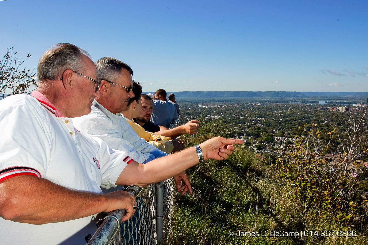 left to right - Lyn Hart, Ed Nordman, and Sandy Nordman (4th guy is not IDed) look from the Grandad's Bluff scenic lookout just east of La Crosse Wisconsin during day 2 of the 2004 'Real People Tour' of middle America. (© James D. DeCamp | http://www.JamesDeCamp.com | 614-367-6366) [Photographed with Canon 1D MkII cameras in RAW mode with L series lenses]