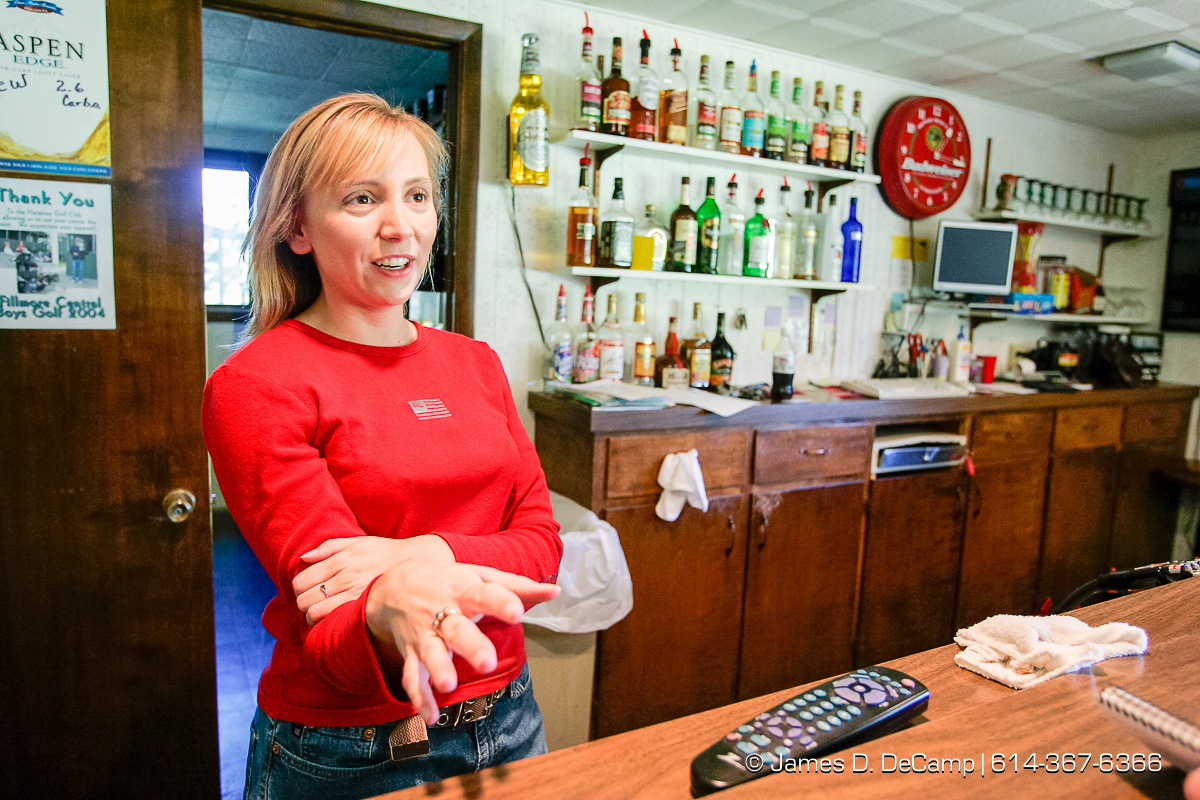 Emily Stumo talks with us from behind the bar at the Harmony Golf Course in Harmony Minnesota photographed Sunday September 26, 2004 on day 3 of the 2004 'Real People Tour' of middle America. (© James D. DeCamp | http://www.JamesDeCamp.com | 614-367-6366) [Photographed with Canon 1D MkII cameras in RAW mode with L series lenses]