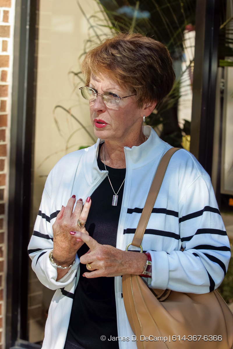 Nancy Martin makes a point outside of the Church of the Nativity in Harmony Minnesota photographed Sunday September 26, 2004 on day 3 of the 2004 'Real People Tour' of middle America. (© James D. DeCamp | http://www.JamesDeCamp.com | 614-367-6366) [Photographed with Canon 1D MkII cameras in RAW mode with L series lenses]