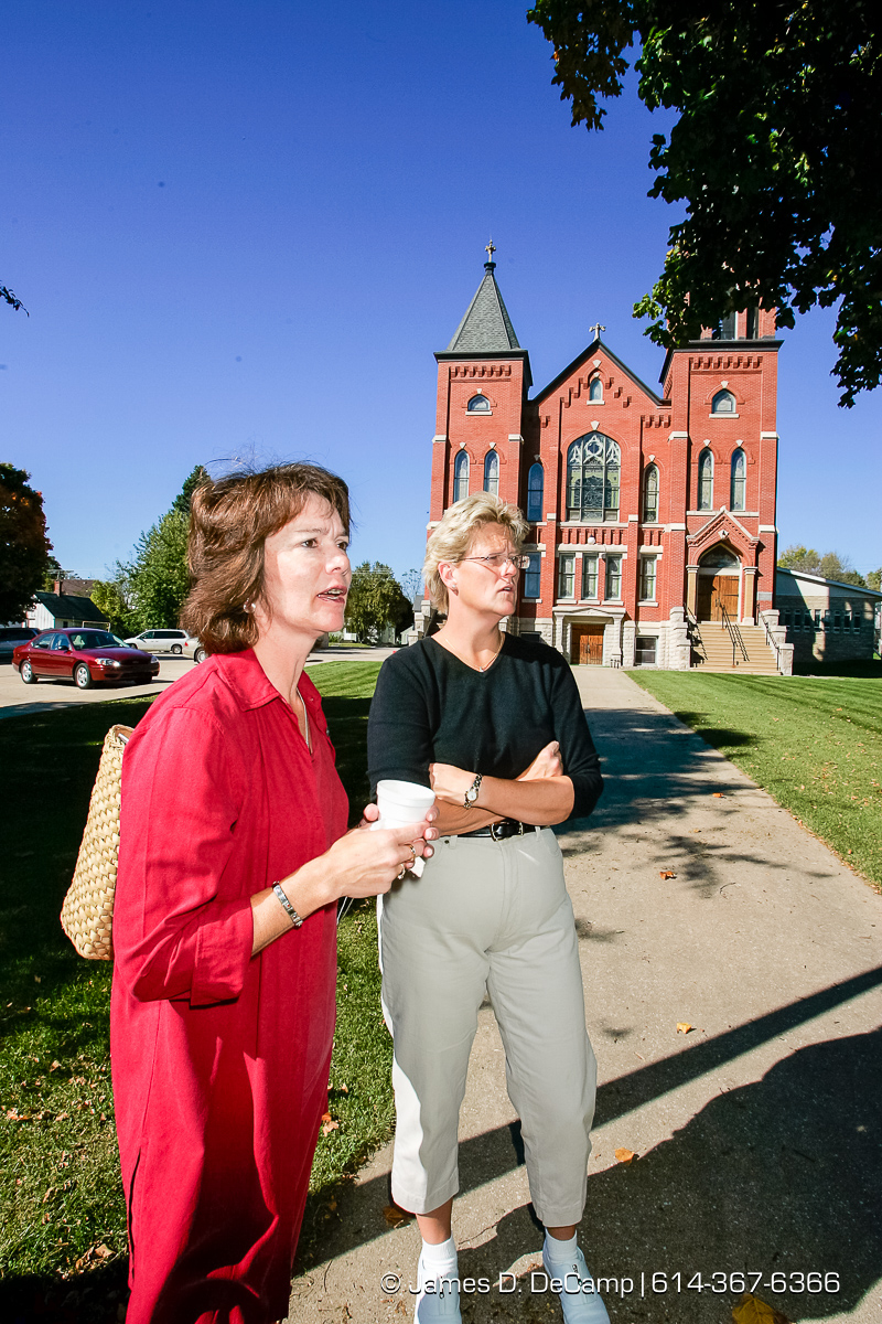 Kari Schroeder, foreground, and Jackie Ward talk outside of the Greenfield Lutheran Church in Harmony Minnesota photographed Sunday September 26, 2004 on day 3 of the 2004 'Real People Tour' of middle America. (© James D. DeCamp | http://www.JamesDeCamp.com | 614-367-6366) [Photographed with Canon 1D MkII cameras in RAW mode with L series lenses]