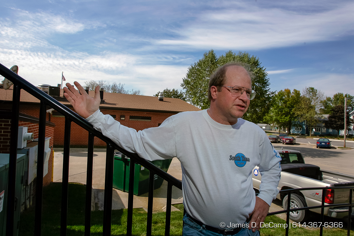 Brent Heeren talks with us at the courthouse in downtown Toledo, Iowa on day 4 of the 2004 'Real People Tour' of middle America. (© James D. DeCamp | http://www.JamesDeCamp.com | 614-367-6366) [Photographed with Canon 1D MkII cameras in RAW mode with L series lenses]