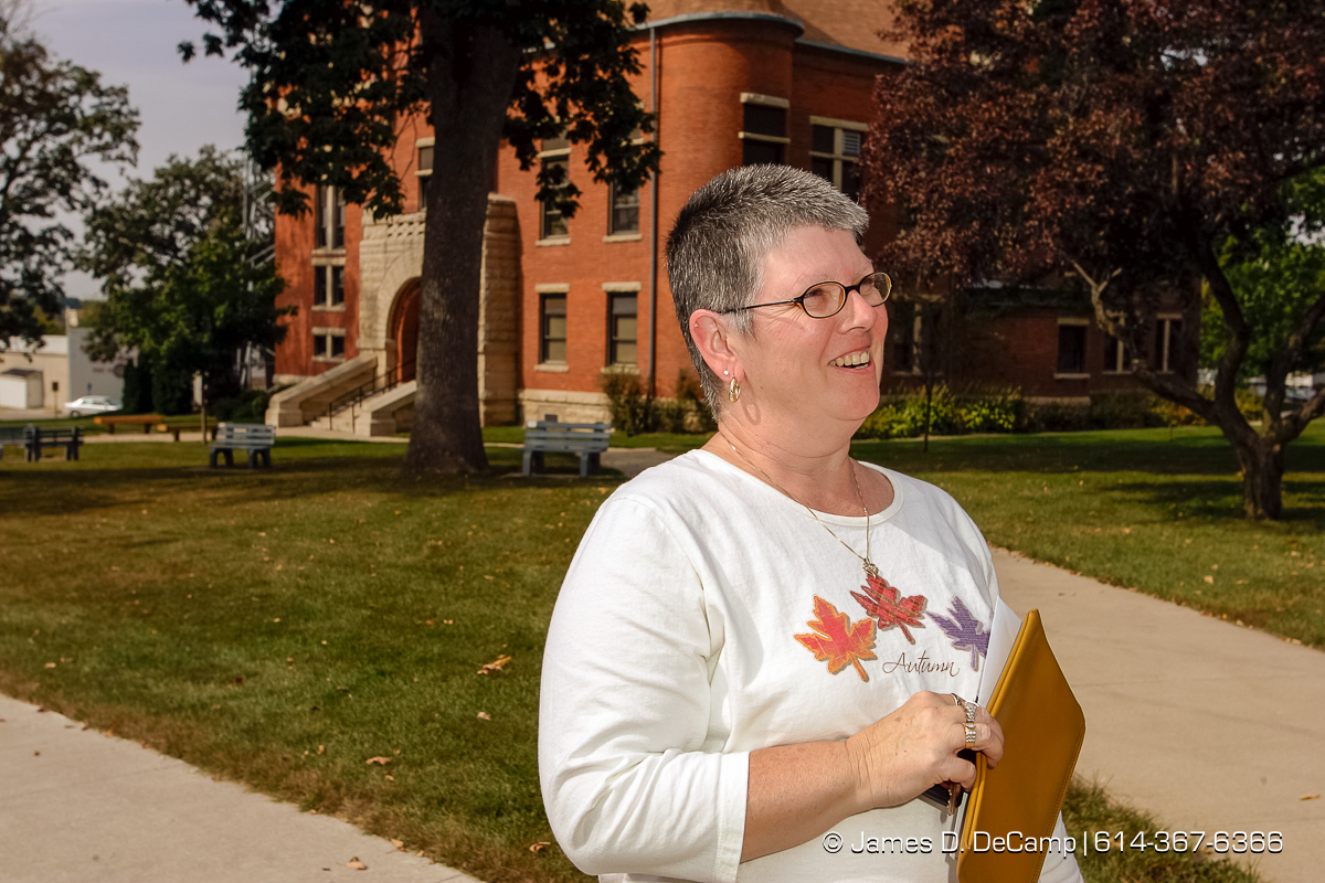 Libby Richardson talks with us at the courthouse in downtown Toledo, Iowa on day 4 of the 2004 'Real People Tour' of middle America. (© James D. DeCamp | http://www.JamesDeCamp.com | 614-367-6366) [Photographed with Canon 1D MkII cameras in RAW mode with L series lenses]