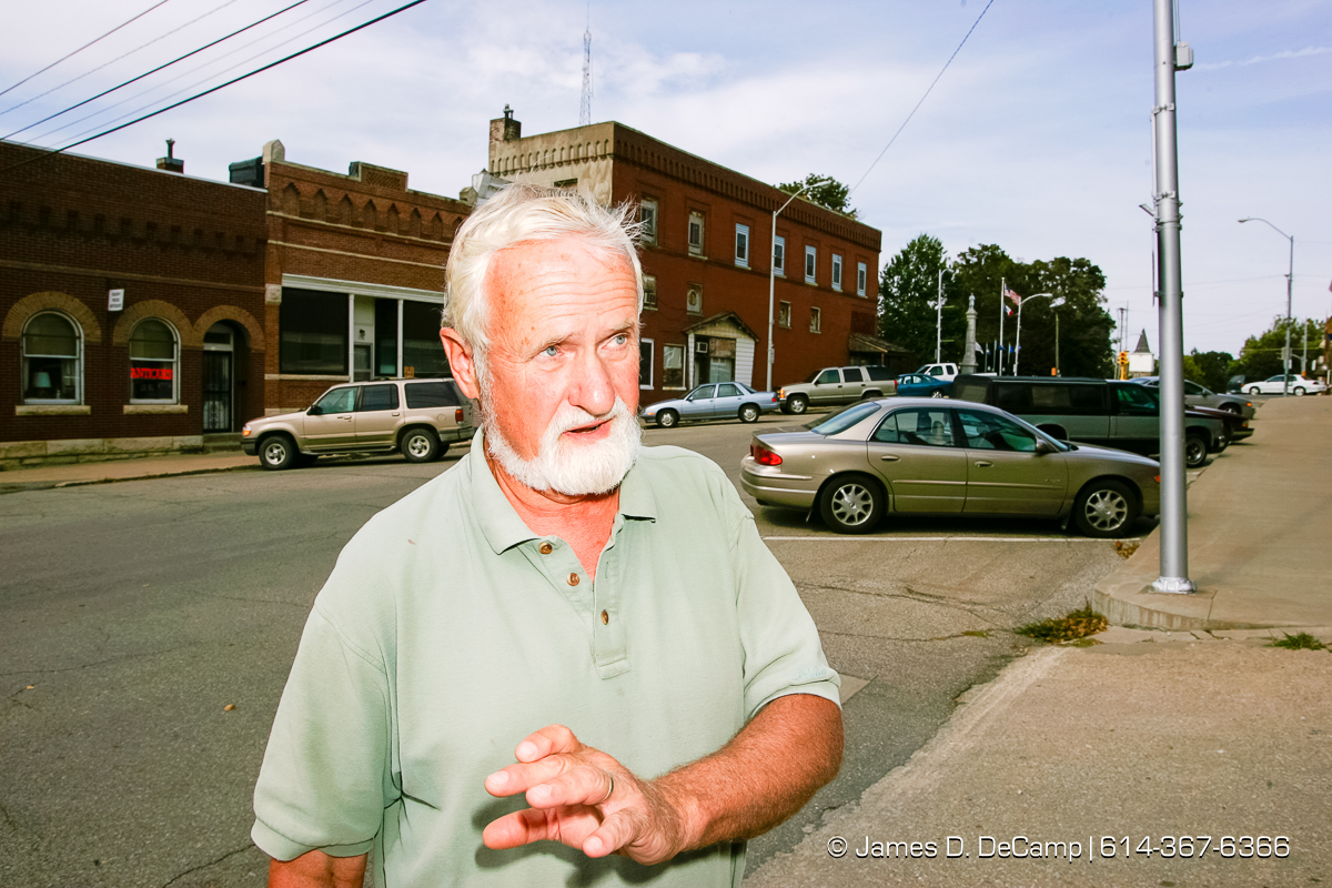 Ray Coleman talks with us in downtown Toledo, Iowa on day 4 of the 2004 'Real People Tour' of middle America. (© James D. DeCamp | http://www.JamesDeCamp.com | 614-367-6366) [Photographed with Canon 1D MkII cameras in RAW mode with L series lenses]