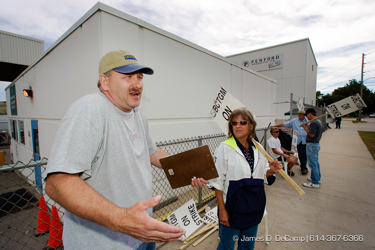 Jim Howard and Debra Evanoff walk the picket lines in front of Penford Products in downtown Cedar Rapids, Iowa on day 4 of the 2004 'Real People Tour' of middle America. The workers have been on strike for more than 8 weeks. (© James D. DeCamp | http://www.JamesDeCamp.com | 614-367-6366) [Photographed with Canon 1D MkII cameras in RAW mode with L series lenses]