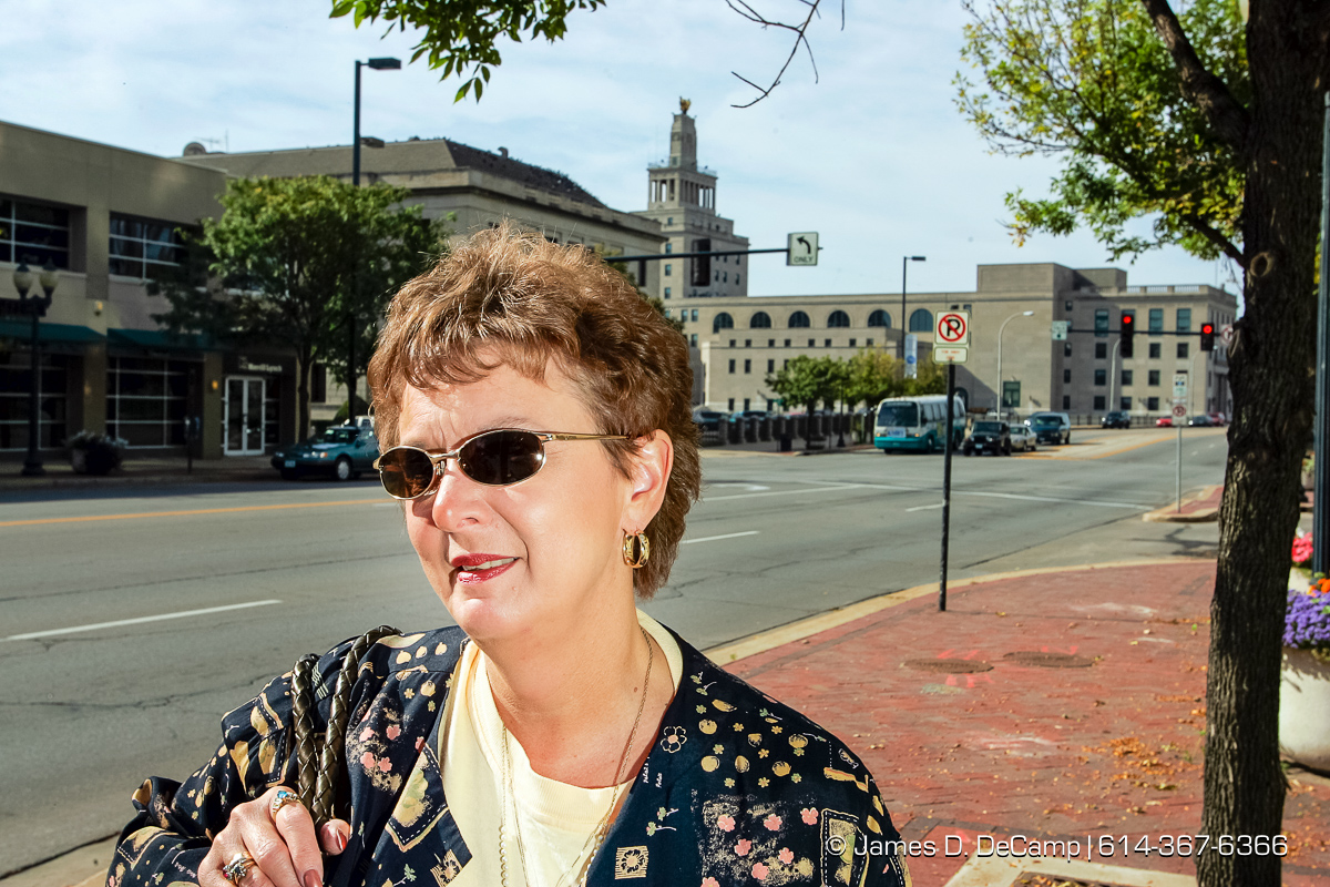 Nancy McCracken talks with us in downtown Cedar Rapids, Iowa on day 4 of the 2004 'Real People Tour' of middle America. (© James D. DeCamp | http://www.JamesDeCamp.com | 614-367-6366) [Photographed with Canon 1D MkII cameras in RAW mode with L series lenses]