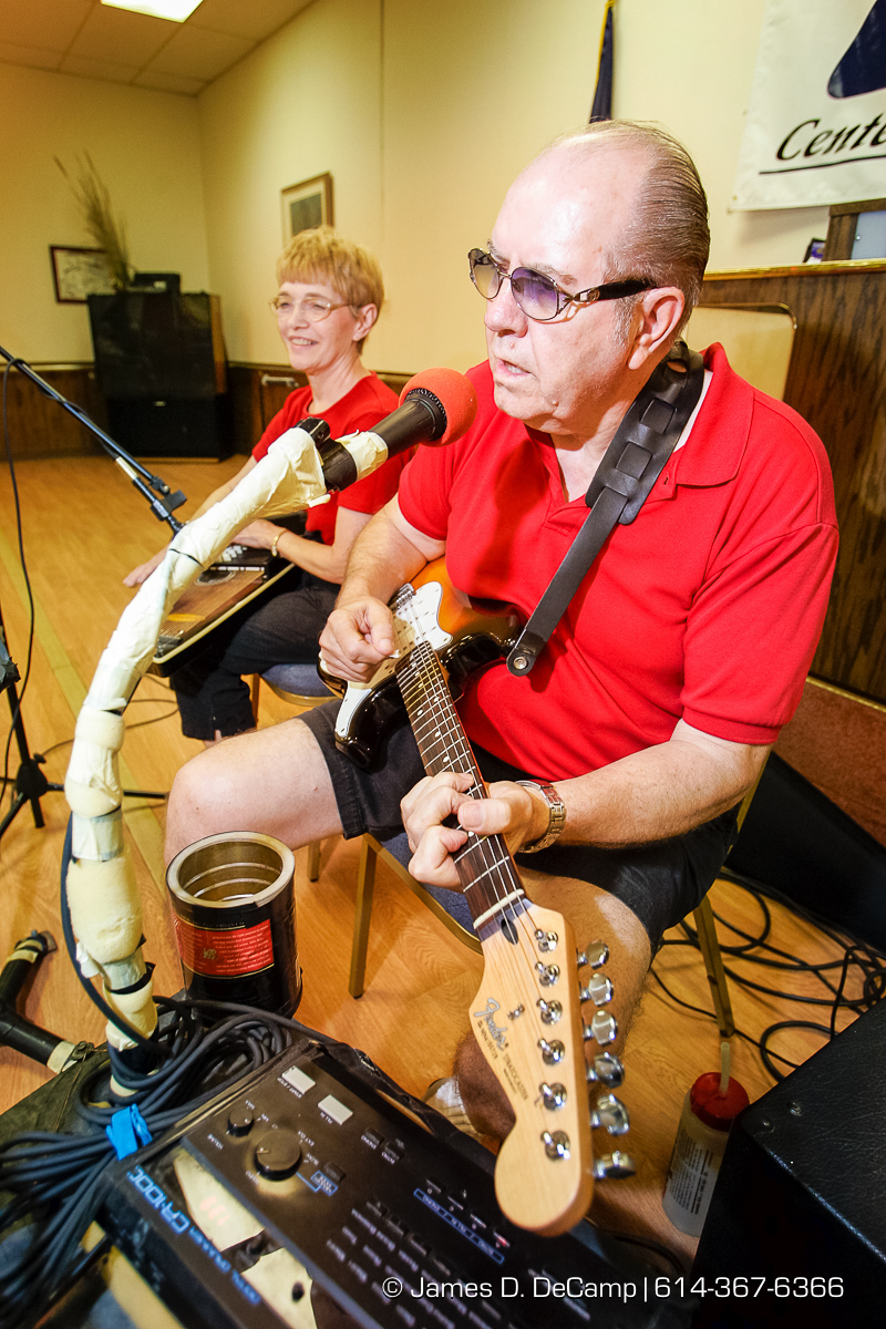 Milt Schatz and his wife Dee Dee play dance and polka music for people at the Center for Active Seniors, Inc. in Davenport, Iowa Tuesday September 28, 2004 during day 5 of the 2004 'Real People Tour' of middle America. (© James D. DeCamp | http://www.JamesDeCamp.com | 614-367-6366) [Photographed with Canon 1D MkII cameras in RAW mode with L series lenses]