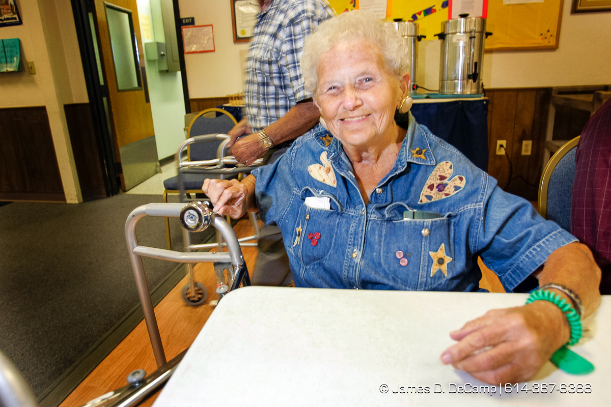 "Mary ""Barbee"" Beintema rings a bell on her walker at the Center for Active Seniors, Inc. in Davenport, Iowa Tuesday September 28, 2004 during day 5 of the 2004 'Real People Tour' of middle America. (© James D. DeCamp 
