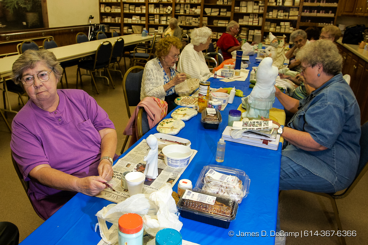 Pat Steffen, left, works on the her ceramics as she talks with us at the Center for Active Seniors, Inc. in Davenport, Iowa Tuesday September 28, 2004 during day 5 of the 2004 'Real People Tour' of middle America. (© James D. DeCamp | http://www.JamesDeCamp.com | 614-367-6366) [Photographed with Canon 1D MkII cameras in RAW mode with L series lenses]