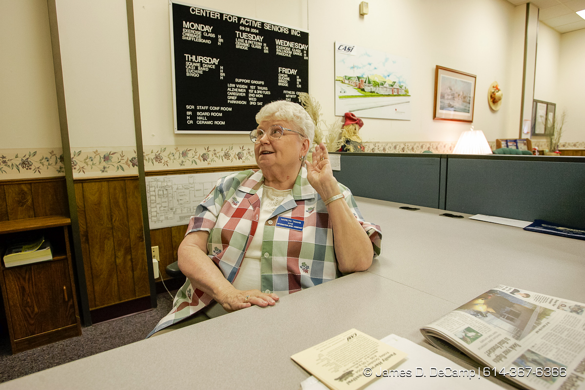 Marilyn Travis mans the front desk at the Center for Active Seniors, Inc. in Davenport, Iowa Tuesday September 28, 2004 during day 5 of the 2004 'Real People Tour' of middle America. (© James D. DeCamp | http://www.JamesDeCamp.com | 614-367-6366) [Photographed with Canon 1D MkII cameras in RAW mode with L series lenses]