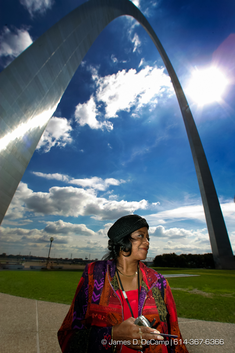 Pamela Busch talks with us under the Arch in downtown St. Louis on Wednesday September 29, 2004 an day 6 of the 2004 'Real People Tour' of middle America. (© James D. DeCamp | http://www.JamesDeCamp.com | 614-367-6366) [Photographed with Canon 1D MkII cameras in RAW mode with L series lenses]