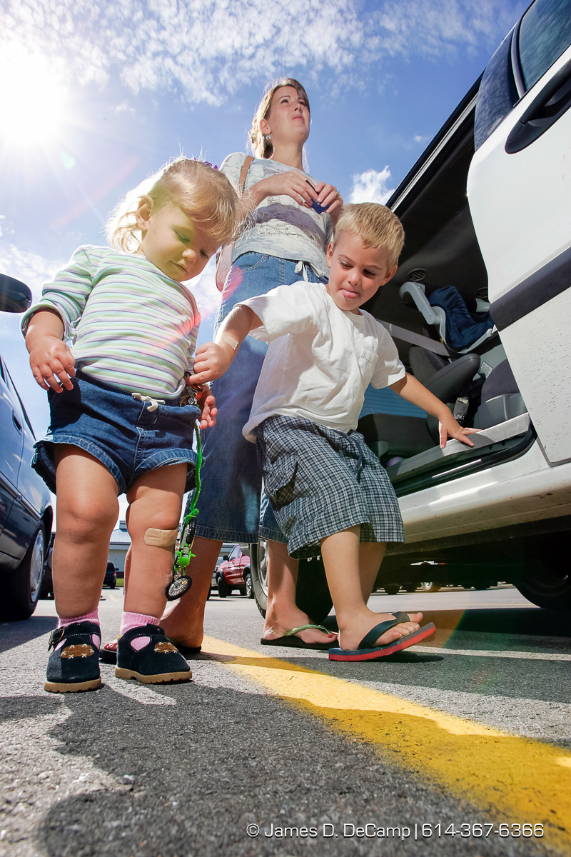 Sharla Hoyt talks with us as her two children Jackson, 3 1/2, right, and Regan, 17 months, in a parking lot in O'Fallon, Missouri on Wednesday September 29, 2004 an day 6 of the 2004 'Real People Tour' of middle America. (© James D. DeCamp | http://www.JamesDeCamp.com | 614-367-6366) [Photographed with Canon 1D MkII cameras in RAW mode with L series lenses]