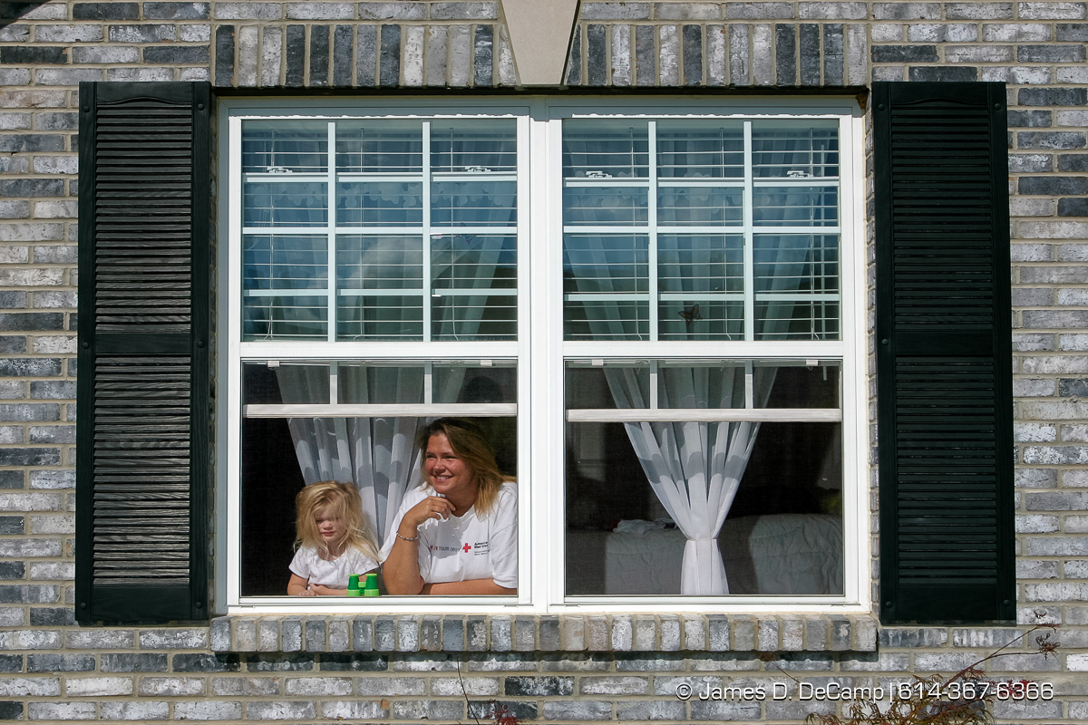 Traci Stark and her daughter Sydney, 3, talk with us from the window of their O'Fallon, Missouri home on Wednesday September 29, 2004 an day 6 of the 2004 'Real People Tour' of middle America. (© James D. DeCamp | http://www.JamesDeCamp.com | 614-367-6366) [Photographed with Canon 1D MkII cameras in RAW mode with L series lenses]
