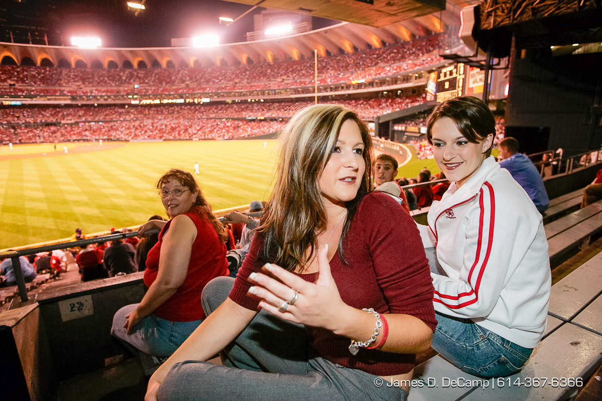 Lauren Becker, left and her cousin Jamie Whitney talk with us in the left field bleachers at Busch Stadium in downtown St. Louis Thursday night September 30, 2004 during day 7 of the 2004 'Real People Tour' of middle America. (© James D. DeCamp | http://www.JamesDeCamp.com | 614-367-6366) [Photographed with Canon 1D MkII cameras in RAW mode with L series lenses]