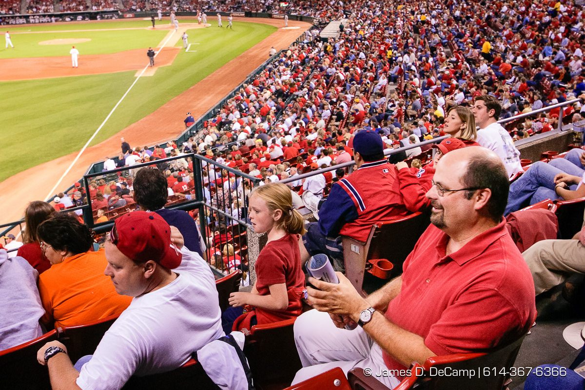 John Petterchak watches a fellow fan catch a foul ball near his left field seat at Busch Stadium in downtown St. Louis Thursday night September 30, 2004 during day 7 of the 2004 'Real People Tour' of middle America. (© James D. DeCamp | http://www.JamesDeCamp.com | 614-367-6366) [Photographed with Canon 1D MkII cameras in RAW mode with L series lenses]