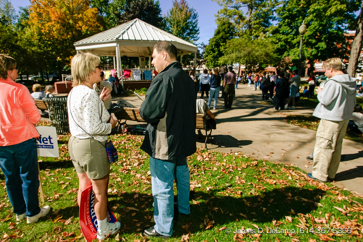 Jonathan Riskind, right, interviews Kathy Trombacco, Erie, PA, at an anti domestic violence rally in downtown Erie, PA Sunday October 3, 2004 on day 10 of the 2004 'Real People Tour' of middle America. (© James D. DeCamp | http://www.JamesDeCamp.com | 614-367-6366) [Photographed with Canon 1D MkII cameras in RAW mode with L series lenses]