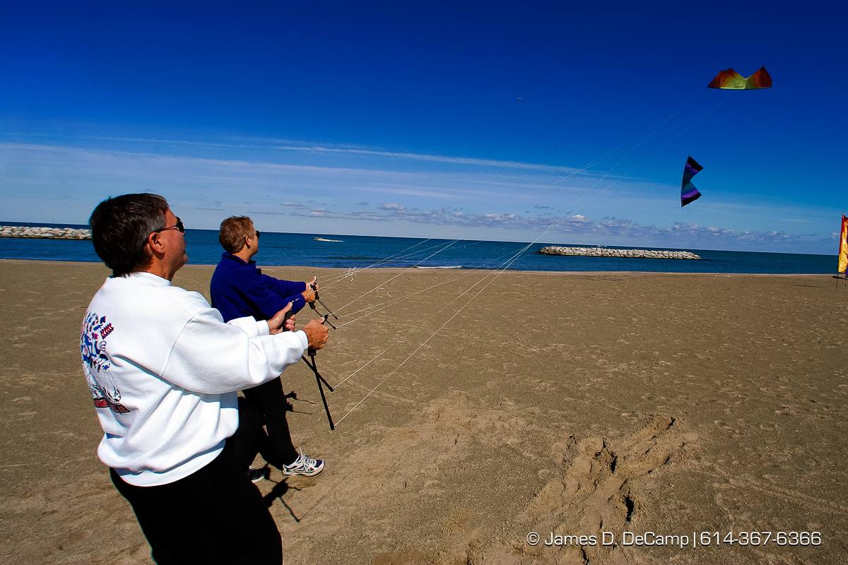 Lee, left, and Sue Sedgewick fly their stacked kites on the beach of the Presque Isle State Park in Erie, PA Sunday October 3, 2004 on day 10 of the 2004 'Real People Tour' of middle America. (© James D. DeCamp | http://www.JamesDeCamp.com | 614-367-6366) [Photographed with Canon 1D MkII cameras in RAW mode with L series lenses]