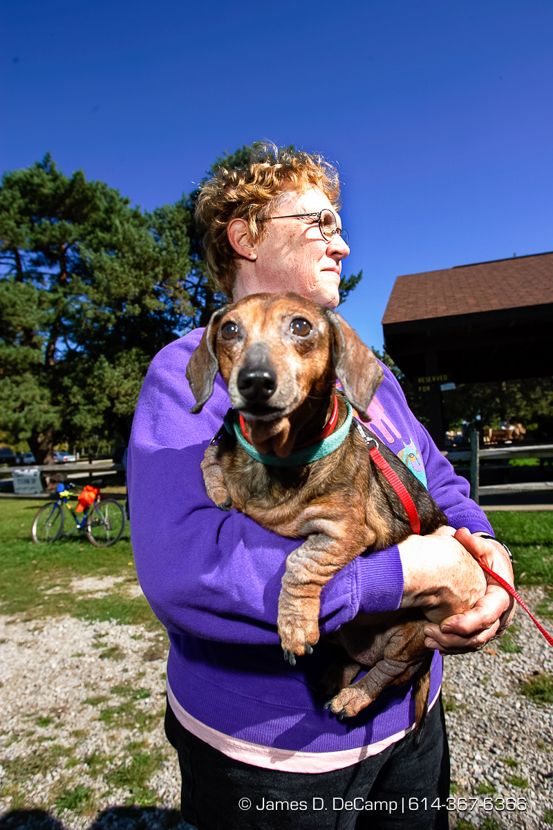 Mary Wolf, holds her 14 year old Doxen 'squirt' at a Dog Walk Athon for the Because You Care Dog Rescue Shelter on the Presque Isle State Park in Erie, PA Sunday October 3, 2004 on day 10 of the 2004 'Real People Tour' of middle America. (© James D. DeCamp | http://www.JamesDeCamp.com | 614-367-6366) [Photographed with Canon 1D MkII cameras in RAW mode with L series lenses]