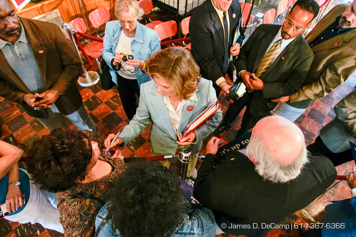 Teresa Heinz Kerry signs a button for a fan after she talk at a political rally at the Teamster Temple (Local 249) in Pittsburgh, PA Monday, October 4, 2004 on day 11 of the 2004 'Real People Tour' of middle America. (© James D. DeCamp | http://www.JamesDeCamp.com | 614-367-6366) [Photographed with Canon 1D MkII cameras in RAW mode with L series lenses]