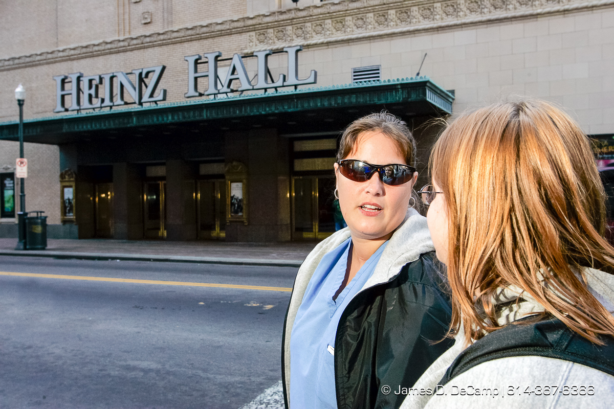 Judy Trautman, left, and Kimberly Pinzok talk together in front of Heinz Hall in Pittsburgh, PA Monday, October 4, 2004 on day 11 of the 2004 'Real People Tour' of middle America. (© James D. DeCamp | http://www.JamesDeCamp.com | 614-367-6366) [Photographed with Canon 1D MkII cameras in RAW mode with L series lenses]