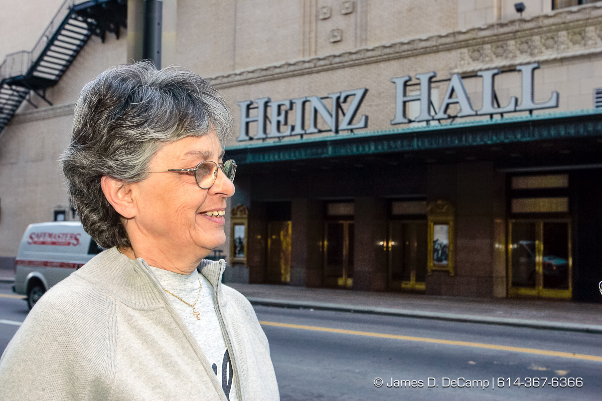 Joyce DiBucci talks with us in front of Heinz Hall in Pittsburgh, PA Monday, October 4, 2004 on day 11 of the 2004 'Real People Tour' of middle America. (© James D. DeCamp | http://www.JamesDeCamp.com | 614-367-6366) [Photographed with Canon 1D MkII cameras in RAW mode with L series lenses]