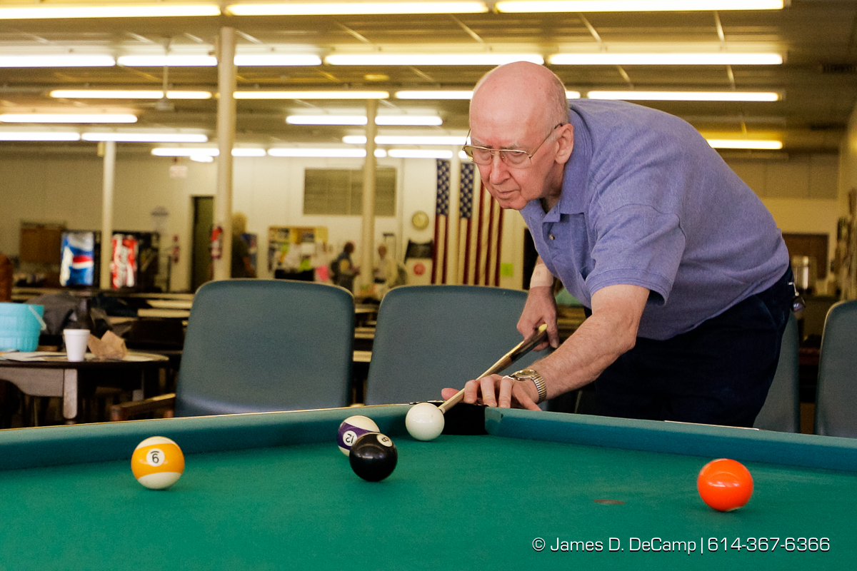 Bucky Kilmartin shoots a mean game of pool at the Weirton Senior Center Tuesday October 5, 2004 on day 12 of the 2004 'Real People Tour' of middle America. (© James D. DeCamp | http://www.JamesDeCamp.com | 614-367-6366) [Photographed with Canon 1D MkII cameras in RAW mode with L series lenses]