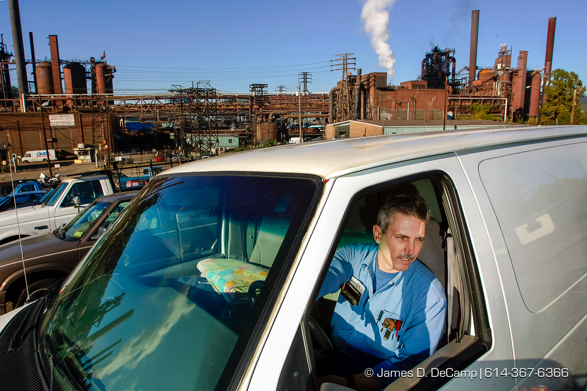 Gordon Meader talks with us from his van in the parking lot of the International Steel Group - Weirton, Inc. Steel Plant in Weirton WVa Tuesday October 5, 2004 on day 12 of the 2004 'Real People Tour' of middle America. (© James D. DeCamp | http://www.JamesDeCamp.com | 614-367-6366) [Photographed with Canon 1D MkII cameras in RAW mode with L series lenses]