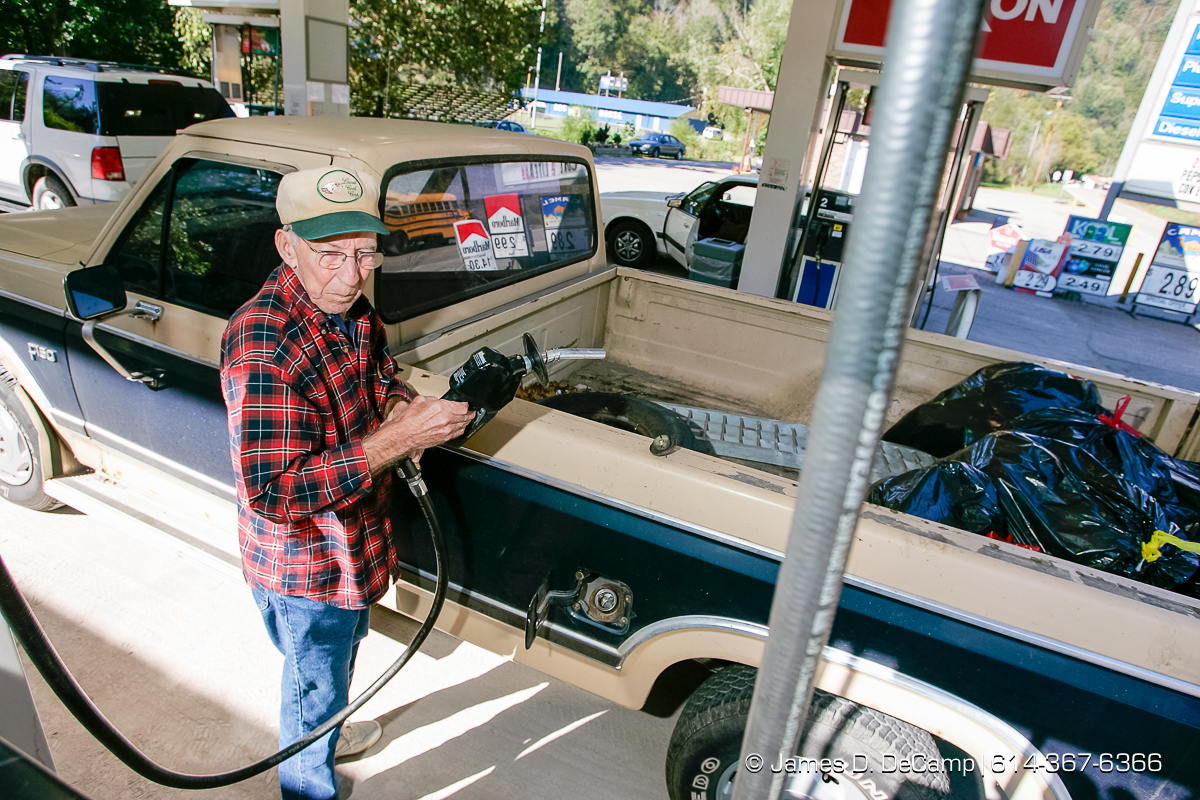 Nathan Tapley, Jr., fuels his truck at an Exxon station in Van, WVa, Wednesday October 6, 2004 on day 13 of the 2004 'Real People Tour' of middle America. (© James D. DeCamp | http://www.JamesDeCamp.com | 614-367-6366) [Photographed with Canon 1D MkII cameras in RAW mode with L series lenses]
