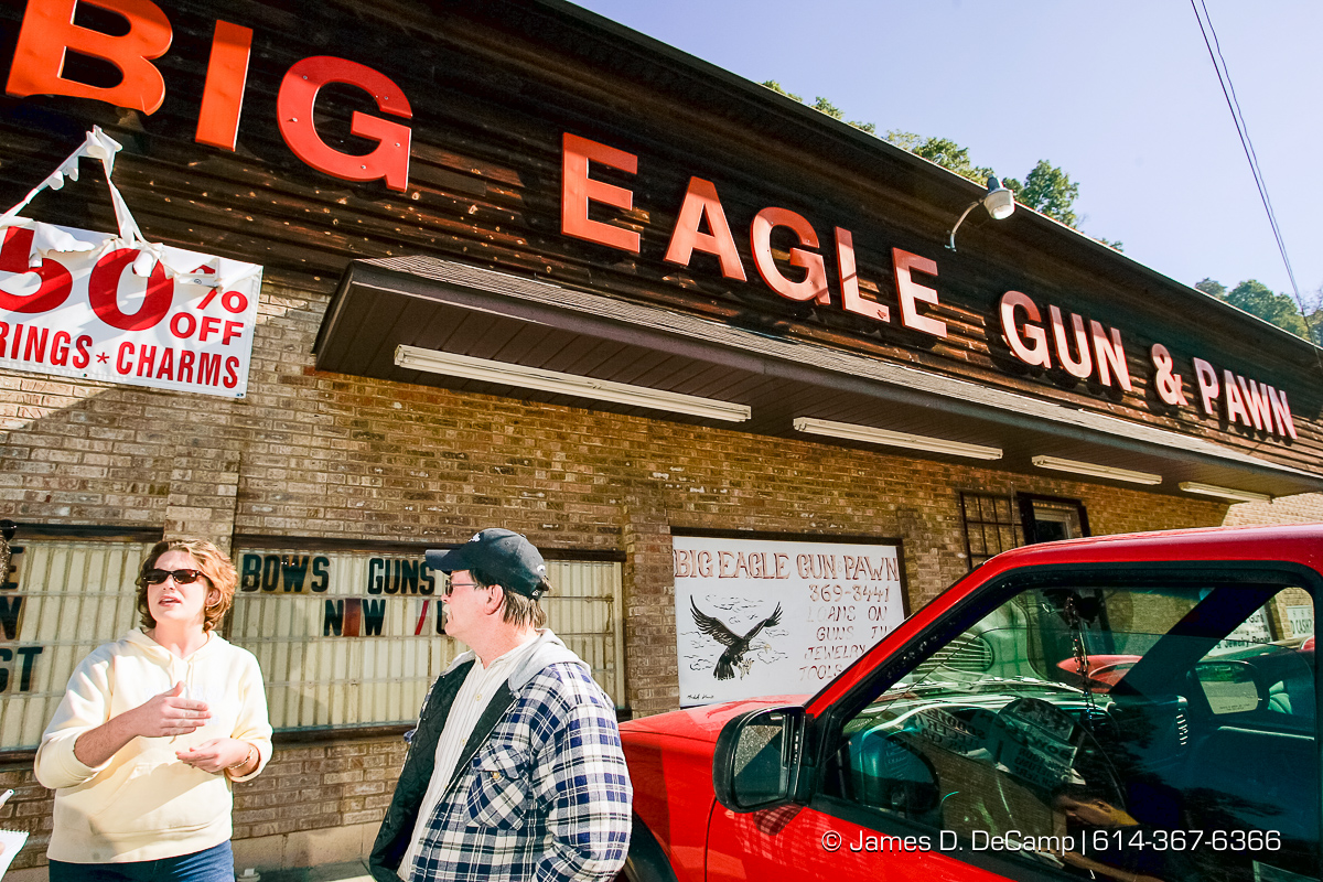 Michelle Mullins and her father Roy R. Hager talk with us outside of the Big Eagle Gun & Pawn Shop in Danville, WVa, Wednesday October 6, 2004 on day 13 of the 2004 'Real People Tour' of middle America. (© James D. DeCamp | http://www.JamesDeCamp.com | 614-367-6366) [Photographed with Canon 1D MkII cameras in RAW mode with L series lenses]