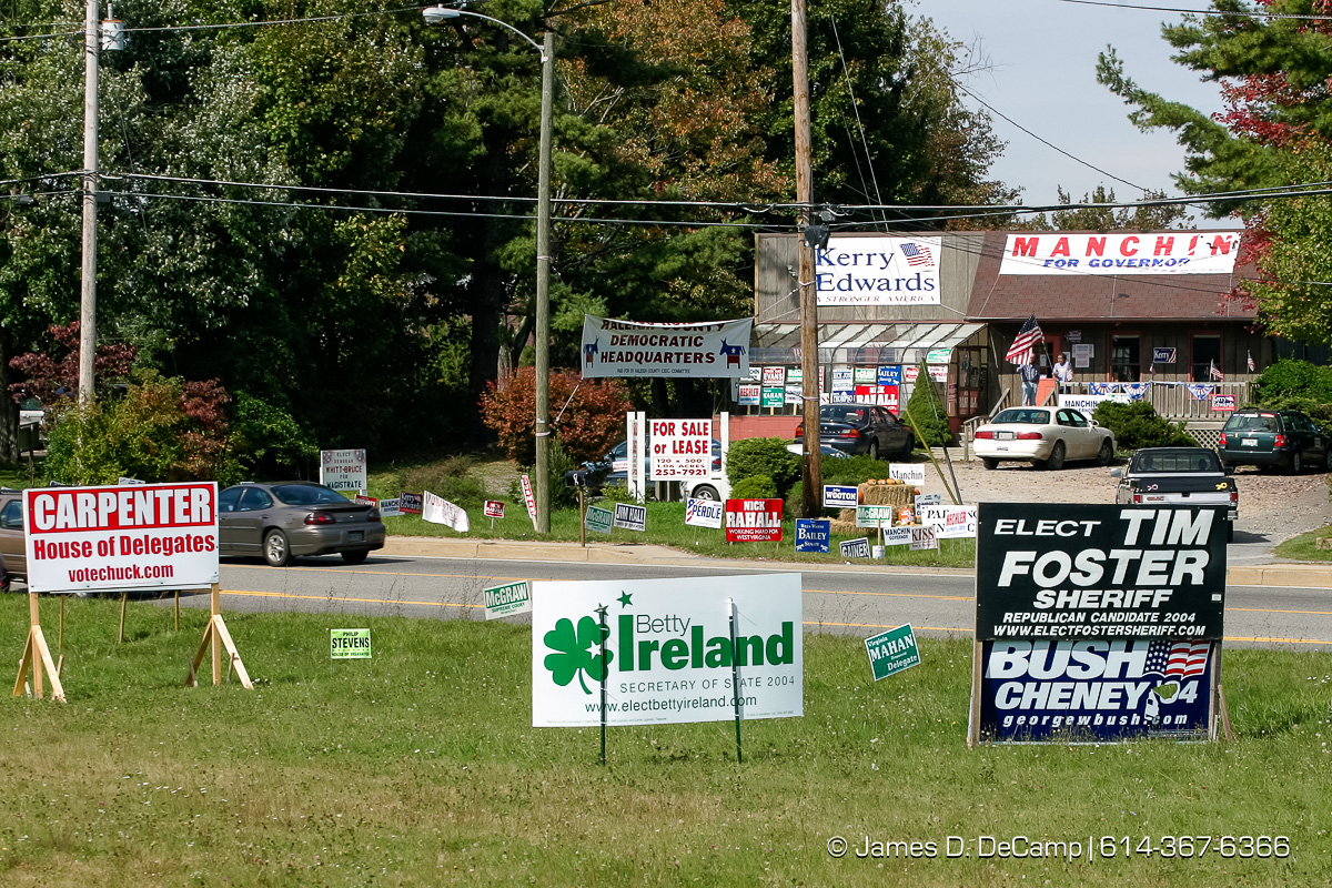 Republican signs line the south side of WVa State Route 3 while Democratic signs line the north side in Beckley WVa Thursday October 7, 2004 on day 14 of the 2004 'Real People Tour' of middle America. (© James D. DeCamp | http://www.JamesDeCamp.com | 614-367-6366) [Photographed with Canon 1D MkII cameras in RAW mode with L series lenses]