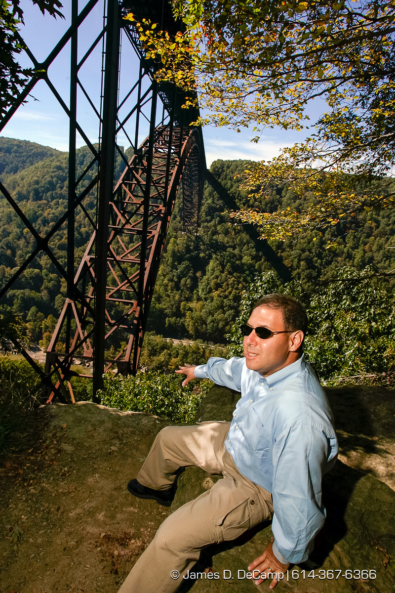 Dispatch reporter Jonathan Riskind contemplates jumping into the New River Gorge in WVa Thursday October 7, 2004 on day 14 of the 2004 'Real People Tour' of middle America. (© James D. DeCamp | http://www.JamesDeCamp.com | 614-367-6366) [Photographed with Canon 1D MkII cameras in RAW mode with L series lenses]