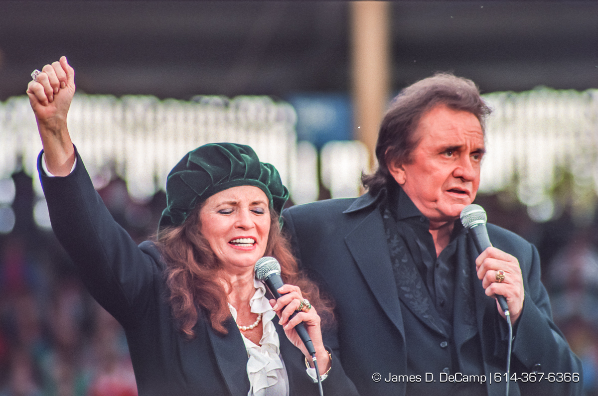 Johnny and June Cash sing at the Greater Columbus Billy Graham Crusade photographed Thursday, September 23, 1993 at Cooper Stadium in Columbus, Ohio. (© James D. DeCamp | http://JamesDeCamp.com | 614-367-6366)
